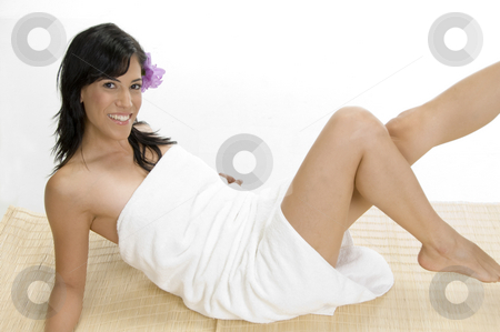 White female laying on mat stock photo, White female laying on mat by Imagery Majestic