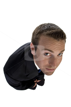 Man looking upside stock photo, Man looking upside against white background by Imagery Majestic