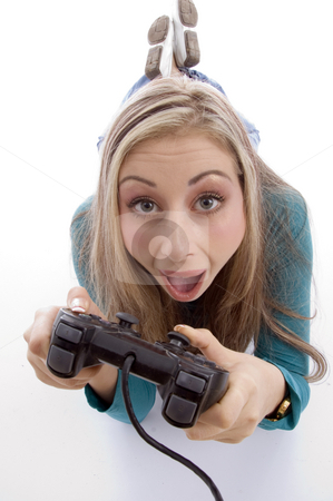 Surprised woman holding remote control stock photo, Surprised woman holding remote control against white background by Imagery Majestic