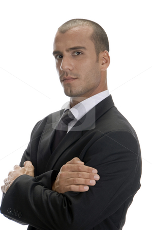 Handsome businessman posing stock photo, Handsome businessman posing with arms crossed and looking to camera by Imagery Majestic