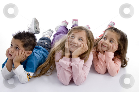 Laying kids looking upward stock photo, Laying kids looking upward on an isolated background by Imagery Majestic