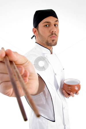 Chef with chopsticks and bowl  stock photo, Chef with chopsticks and bowl against white background by Imagery Majestic