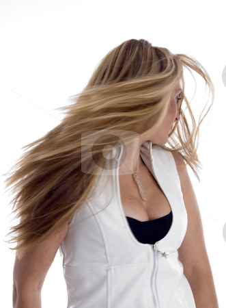 Woman blowing her hair stock photo, Woman blowing her hair with white background by Imagery Majestic