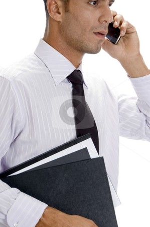 Adult american businessman busy on phone call stock photo, Adult american businessman busy on phone call with white background by Imagery Majestic