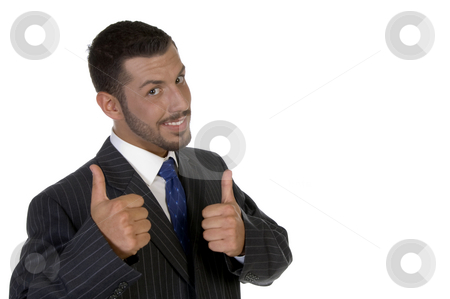 Young executive wishing good luck stock photo, Young executive wishing good luck on an isolated white background by Imagery Majestic