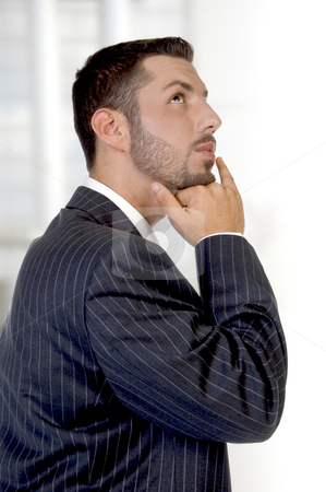 Thinking young executive stock photo, Thinking young executive on an abstract background by Imagery Majestic