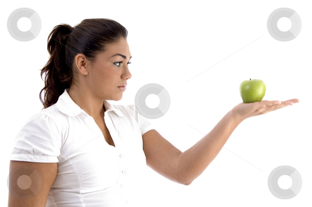 Woman looking the apple stock photo, Woman looking the apple with white background by Imagery Majestic