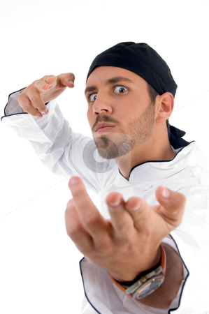 Chef making hand gesture stock photo, Chef making hand gesture on an isolated white background by Imagery Majestic