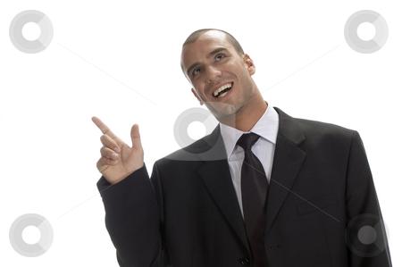 Happy businessman pointing stock photo, Happy businessman pointing to back side by Imagery Majestic