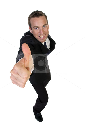 Successful businessman showing thumbsup stock photo, Successful businessman showing thumbsup with white background by Imagery Majestic