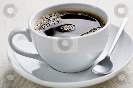 Coffee stock photo, Cup of freshly brewed black coffee, focus is on the middle bubbles by Liv Friis-Larsen