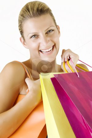 Happy shopper stock photo, Young smiling woman with colorful shopping bags by Liv Friis-Larsen
