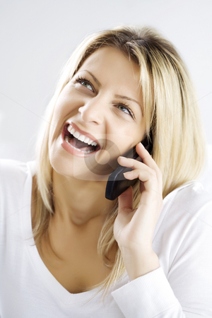 Happy conversation stock photo, Young woman talking on he phone, laughing by Liv Friis-Larsen