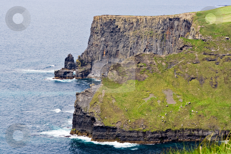 Shoreline and Cliffs stock photo, The Cliffs of Moher in County Clare, Ireland. This is on the Atlantic Ocean shoreline. by Stephen Bonk