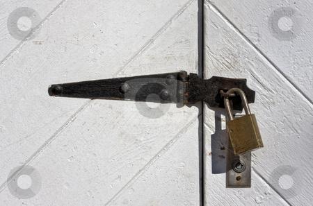 Padlock on Doors stock photo, A locked padlock on old doors by Stephen Bonk