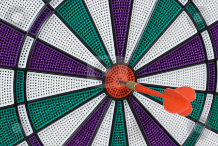 Bullseye stock photo, Dartboard with dart in center (bullseye) by Stephen Bonk
