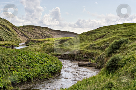 Stream in Ireland stock photo, A stream in rolling hills of Ireland by Stephen Bonk