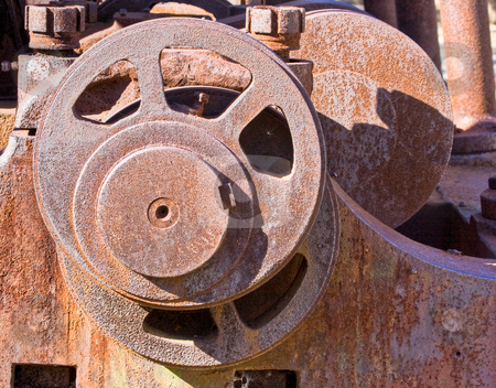 Gears stock photo, Metal gears from an old steam engine train by Stephen Bonk