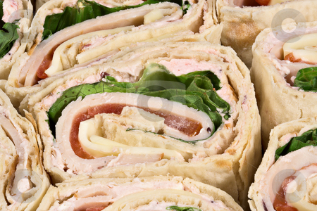 Turkey Wrap stock photo, A sliced turkey wrap sandwich by Stephen Bonk
