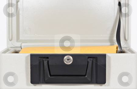 Fire Proof Box 4 stock photo, An open fire proof box with a large yellow envelope inside by Stephen Bonk