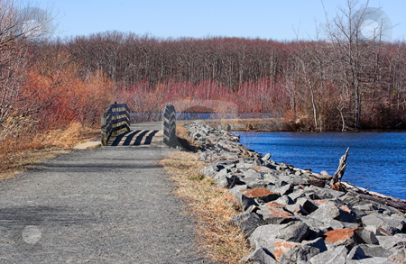 Reservoir in the Winter stock photo, A path around Manasquan Reservoir in New Jersey during a nice winter day. by Stephen Bonk
