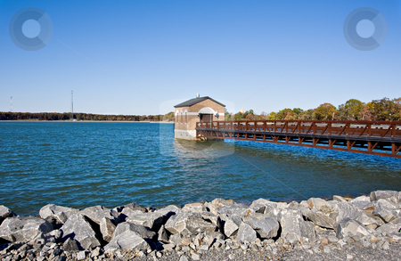 Reservoir stock photo, A reservoir with a pier and a building over the water by Stephen Bonk