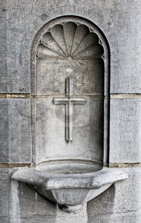 Cross and Holy Water Well stock photo, A cross and holy water well as part of the architecture in a cathedral by Stephen Bonk