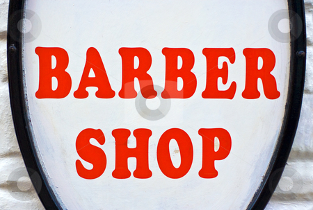 Barber Shop Sign stock photo, A Barber Shop sign with red letters and a white background by Stephen Bonk