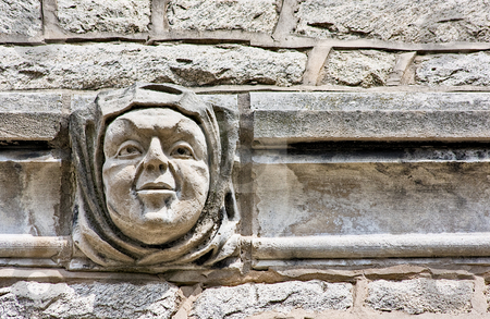 A Face in the Wall stock photo, A face embedded in the architecture of a building wall by Stephen Bonk