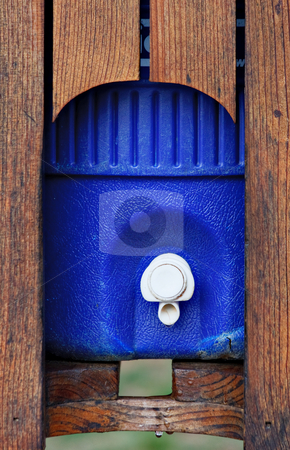 Water Thermos stock photo, A large water cooler or thermos in a wood casing by Stephen Bonk