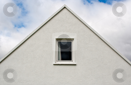 Abstract House Top stock photo, An abstract image of the top of a house. The house forms a triangle against a cloudy sky. by Stephen Bonk