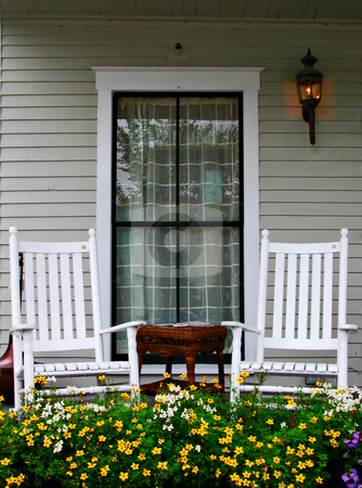 Porch and Chairs stock photo, A porch with two chairs and a flower bed by Stephen Bonk
