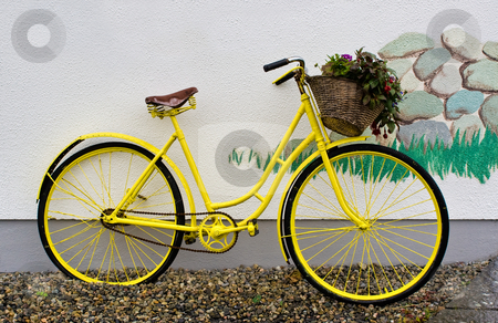Yellow Bike stock photo, A yellow bike leaning on a white wall by Stephen Bonk