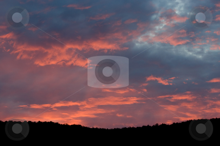 Sunset Over Mountain Top stock photo, A colorful evening sunset over the silhouette of a mountain range by Stephen Bonk