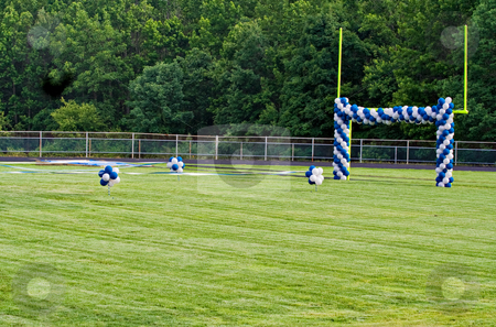 Goal Post and Balloons stock photo, A High School football field with goal posts decorated with balloons. The field decorations are preparations for a graduation ceremony. by Stephen Bonk