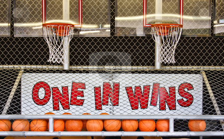 One in Wins stock photo, A basketball game of chance on a boardwalk by Stephen Bonk