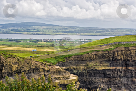Cliffs of Moher stock photo, The top of the Cliffs of Moher in Ireland with a river and valley behind them by Stephen Bonk
