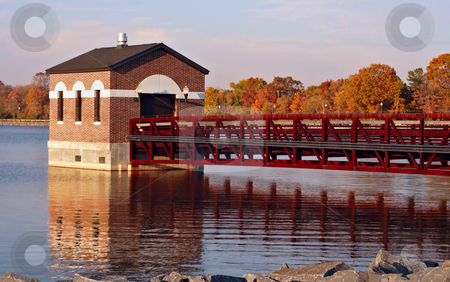 Reservoir stock photo, Reservoir in the fall with colorful leaves and reflections in the water by Stephen Bonk