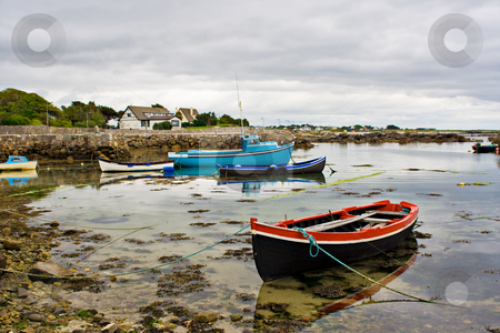 Boats on Galway Bay stock photo, Several boats tied up on the edge of Galway Bay, Ireland. by Stephen Bonk