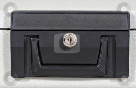 Fire Box 2 stock photo, Front of a fire proof lock box with key in keyhole by Stephen Bonk