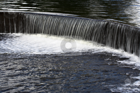 Water Over a Dam stock photo, Water flowing over a manmade dam in a lake by Stephen Bonk