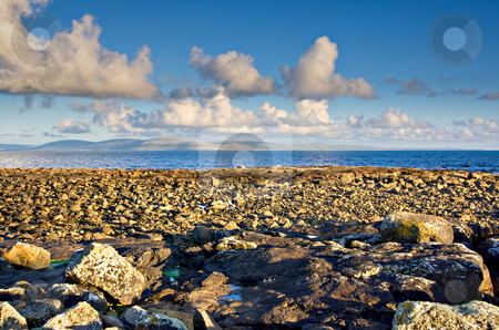 Galway Bay stock photo, Galway Bay in Ireland with The Burren in the background by Stephen Bonk