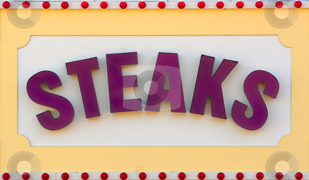 Steaks Sign stock photo, Large sign advertising steaks by Stephen Bonk