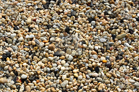 Pebbles stock photo, Small pebbles of different colors filling the entire frame by Stephen Bonk