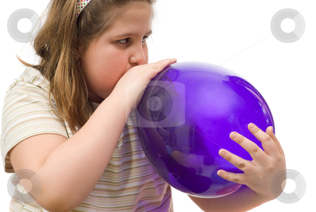 Blowing Up A Balloon stock photo, Closeup of a young girl blowing up a blue balloon, isolated against a white background by Richard Nelson