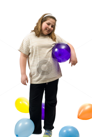Birthday Girl stock photo, A young girl standing with various colored balloons, shot against a white background by Richard Nelson