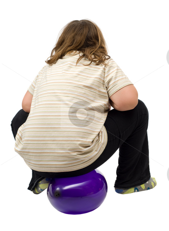 Child Sitting On Balloon stock photo, A young girl sitting on a balloon isolated against a white background by Richard Nelson