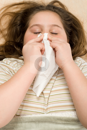 Sick In Bed stock photo, A young girl lying in bed with a cold by Richard Nelson