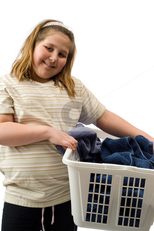 Bath Towels stock photo, A happy young girl carrying a laundry basket of towels, isolated against a white background by Richard Nelson