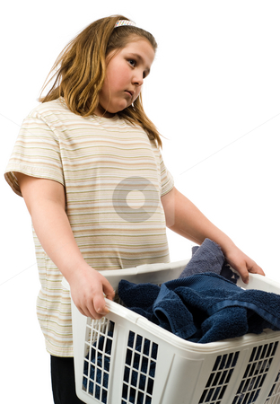 Laundry stock photo, A young girl holding a basket of dirty towels that she is going to wash by Richard Nelson